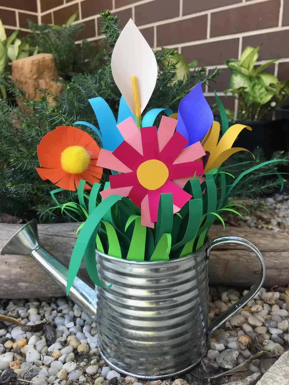 Les Petits Painters school holidays art camp for kids, paper sculpture for children 5-9 years old, paper cut, folded, formed to create a bouquet in a watering can