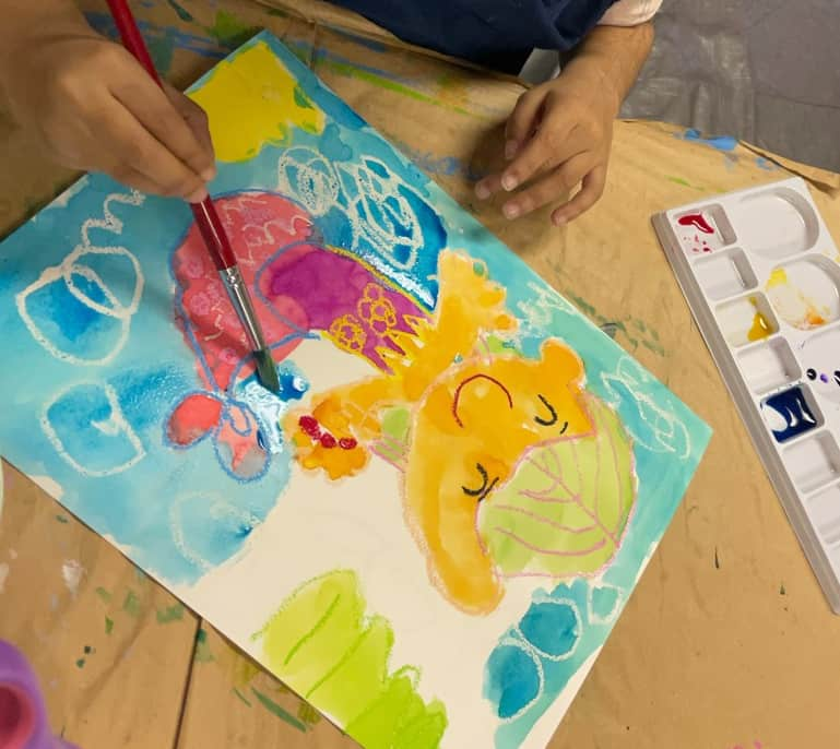 Les Petits Painters art classes for preschoolers, water resist oil pastel drawing and painting, draw using oil pastels and paint over with watercolours to reveal the lines, use contrasting colours (dark paint over light pastels and the opposite) for better contrast, little mermaid under the sea art